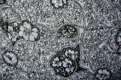 Floral textile fabric. Black floral textile on fabric in motif style stock photos