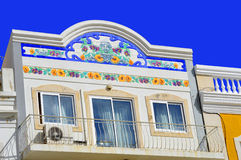 Floral tiles on the front of a house with a balcony in Loule. Portugal Royalty Free Stock Images