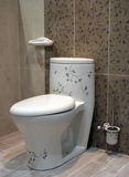 Floral toilet - home interiors royalty free stock photography
