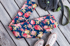 Floral trousers with denim purse. Stock Image