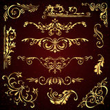 Floral vector set of golden ornate page decor elements like banners, frames, dividers, ornaments and patterns on dark Stock Images