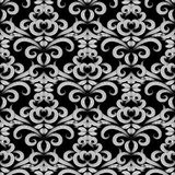 Floral vintage black and white seamless pattern. Vector damask b. Ackground with doodle striped hand drawn flowers, swirl curve laves, line art tracery ornaments stock illustration