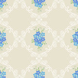 Floral vintage seamless pattern with forget-me-not flowers on a beige background Royalty Free Stock Photography