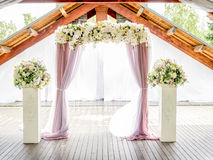 Floral wedding arch of roses and lillies Stock Image