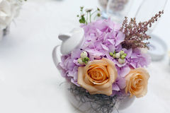 Floral wedding arrangement. Floral bouquet in a porcelain kettle Royalty Free Stock Photos