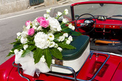 Floral wedding bouquet on vintage car Stock Photo