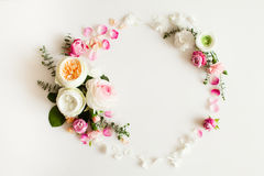 Floral wedding frame. Floral round wedding frame flat lay. Rose flowers top view with copy space Stock Photos
