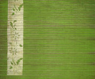 Floral white bamboo banner print on green wood. En slats royalty free stock images