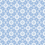 Floral white lacy seamless pattern on blue Royalty Free Stock Images