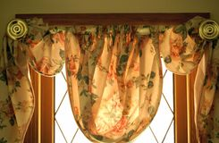 Floral window covering Stock Image