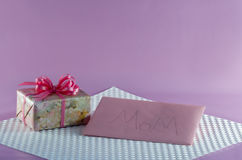 Floral Wrapped Gift and Card for Mom Royalty Free Stock Photos