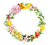 Floral wreath - blooming flowers, field grass. Watercolor round border. Floral wreath with blooming flowers, field grass. Watercolor round border Royalty Free Stock Photography