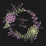Floral wreath on the dark background. Stock Photos