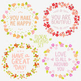 Floral wreaths set. Collection design stylish beautiful floral wreaths with positive phrases Stock Photos