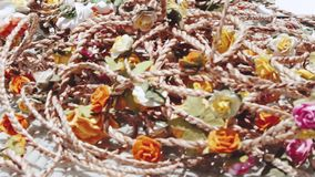 Floral wreaths on the table. Closeup floral wreaths on the table. Summer party concept stock video footage