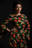 Florals. A woman in a black floral dress Stock Images