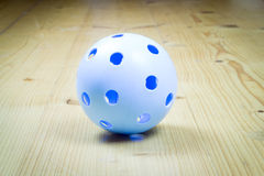 Florbal ball on the wooden floor, sport royalty free stock image