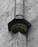 Floreal corner under the column in nice colors. Shot in black and white and painted in colors, detail on the sculpture on the facade of this historic building Royalty Free Stock Photos