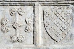 Florence. Detail of the Basilica of Santa Maria Novella - famous landmark of Florence, Italy. Cross and shield Royalty Free Stock Image