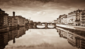 Florence. Sepia style photo of Arno river-view from Ponte Vecchio,Florence ,Italy.Historic centre of Florence is at Unesco World Heritage List Stock Photography