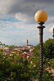 Florence. Landscape with lantern in park and in background Palace Vecchio in Florence capitol city of medieval Tuscany,Italy.Historic centre of Florence is on a Royalty Free Stock Images