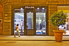 FLORENCE, 20 AUGUST 2016 - Girl walks in front of Prada shop in royalty free stock image