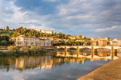 Florence bridge on the Arno river. View of Ponte alle Grazie on the Arno river with reflections Stock Image