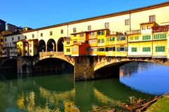 Florence bridge , Italy. Urban secene in Florence city , Italy . Ancient bridge over the main river called Arno. Ponte Vecchio , the old bridge on a winter day Stock Images