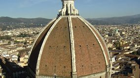 Florence Brunelleschi Dome, close and quick vertical panning Bottom to. The great Dome of the Cathedral of Florence is shot from above, with the city view on stock footage