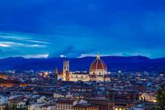 Florence Cathedral and the city of Florence, Italy at night stock image