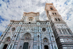 Florence cathedral gothic facade. Facade of Basilica di Santa Maria del Fiore and Giotto's Bell Tower royalty free stock photography