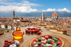 Florence cathedral with pizza in  Italy. Florence with Cathedral and typical Italian pizza in Tuscany, Italy Stock Photography