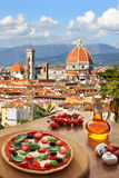 Florence cathedral with pizza in  Italy. Florence with Cathedral and typical Italian pizza in Tuscany, Italy Royalty Free Stock Photo