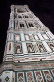 Florence Cathedral tower at night, Italy. Tower of Florence Cathedral illuminated showing statuary against night skies Stock Photo