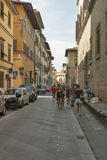 Florence city narrow street with parked cars Stock Photo