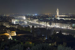 Florence city at night. Aerial view of Florence city at night looking over Arno river, Tuscany, Italy royalty free stock images