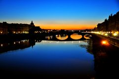 Florence city by night, Italy. Urban night secene in Florence city , Italy . Ancient bridges over the main river called Arno. Ponte Vecchio , the old bridge on a Stock Photos