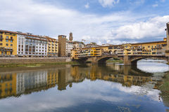 Florence city.View of Ponte Vecchio bridge in Italy. Close-up view of the bridge-old, Arno River in the foreground flowing under the arches Stock Images