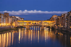 Florence city.View of Ponte Vecchio bridge in Italy. Long exposure night, after sunset on the old bridge in Florence, under the river Arno in Tuscany, symbol of Royalty Free Stock Images