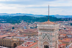 Florence cityscape. Aerial view to Florence, Italy, from a roof. Photo also contains top part of famous Giotto's bell tower Royalty Free Stock Image