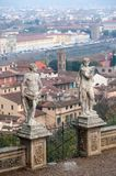 Florence cityscape from Villa Bardini. Two statues male and female in the foreground. Florence, Italy - 2018, November 11: Two statues in the gardens of Villa stock photography