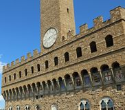 Florence Clock Tower of Old Palace also called Palazzo Vecchio i. Florence Italy Clock Tower of Old Palace also called Palazzo Vecchio in Italian Language Royalty Free Stock Photography