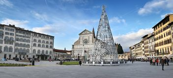Florence, December 2018: Christmas tree in Piazza Santa Maria Novella at Florence. Christmas tree with the Basilica royalty free stock image