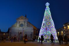 Florence, December 2018: Illuminated Christmas Tree in Piazza Santa Maria Novella with the Basilica on background royalty free stock photography