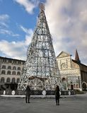 Florence, December 2018: Tourists and Christmas tree in the square of Santa Maria Novella with the Basilica on the background. stock image