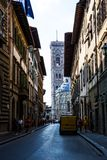 Florence Duomo Cathedral seen from side street. Florence Duomo Cathedral and piazza seen from a city side street in Italy Royalty Free Stock Photos