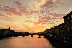 Florence at dusk. Florence Italy, Santa Trinita bridge at sunset Stock Image