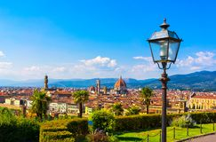 Florence cityscape. Panorama view from Michelangelo park. Florence or Firenze cityscape with tree and street lamp. Panorama view from Michelangelo park square Stock Photography