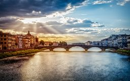 Florence Firenze in the end of the day. Florence Firenze. Ponte alla Carraia bridge over river Arno in the end of the day sunset Royalty Free Stock Photography