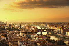 Florence or Firenze sunset Ponte Vecchio bridge panoramic view.T Stock Photos